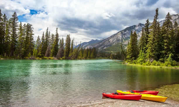 Canoes at the Bow River in Banff National Park Alberta Canada stock photo