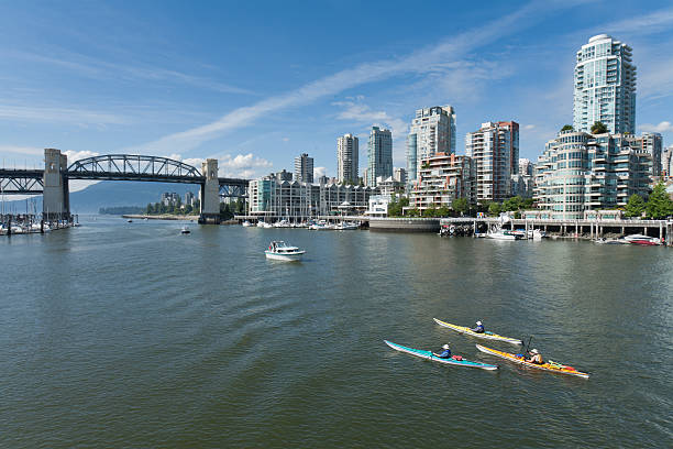 Canoes in Vancouver Harbour stock photo