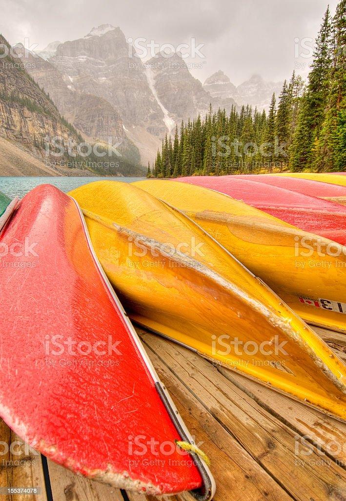 Canoes line dock at Moraine Lake, Banff National Park royalty-free stock photo