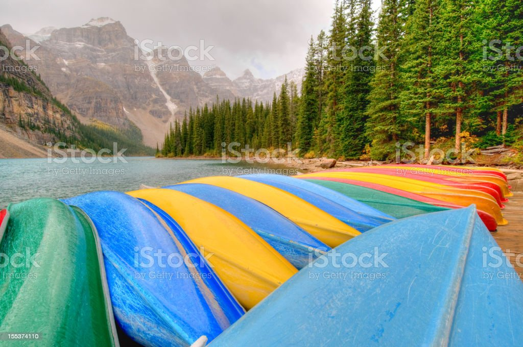 Canoes line dock at Moraine Lake, Banff National Park royalty-free stock photo
