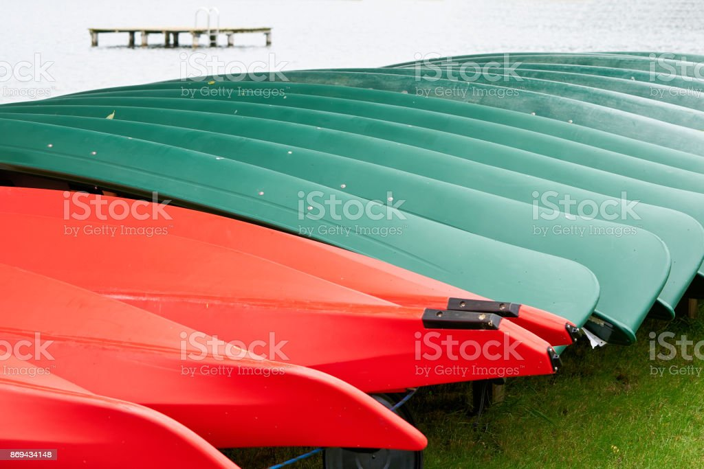 Canoes on a boat rental stock photo