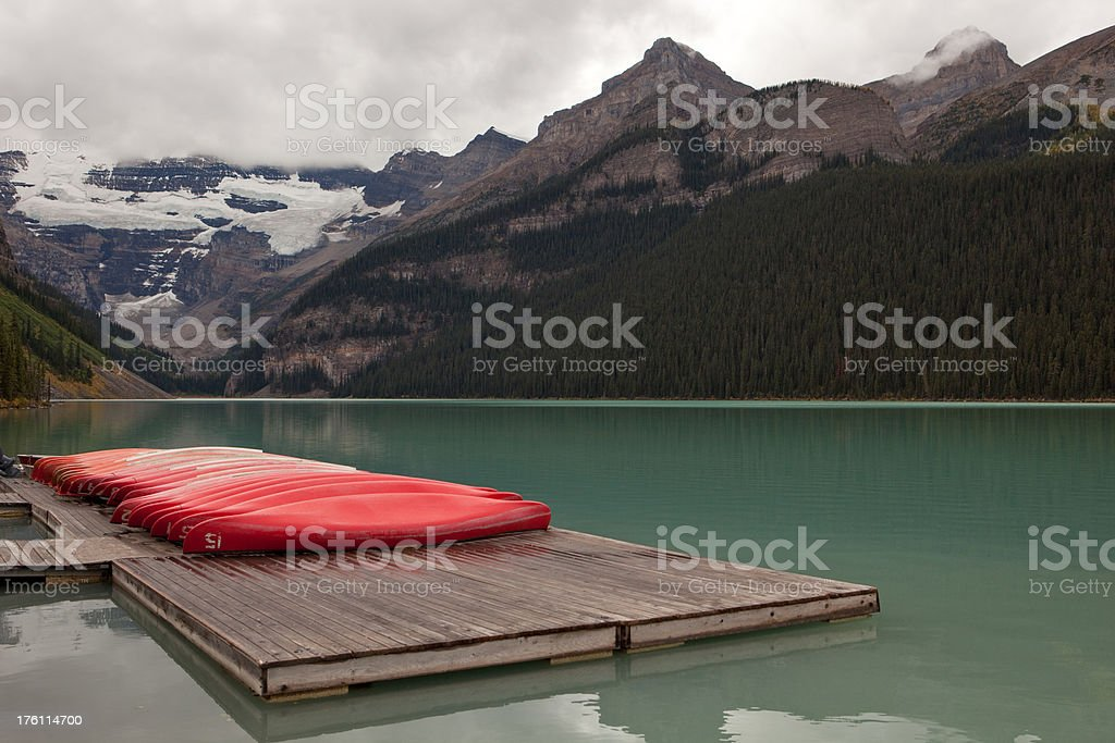 Canoes on a dock at Lake Louise royalty-free stock photo