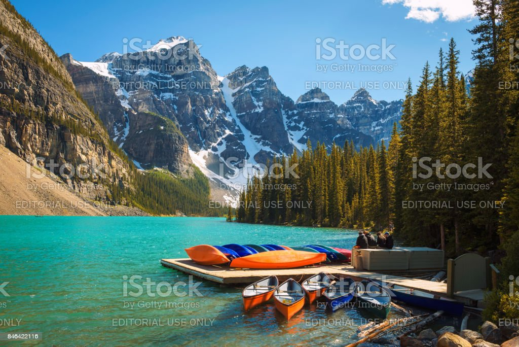 Canoes on a jetty at  Moraine lake in Banff National Park, Canada stock photo