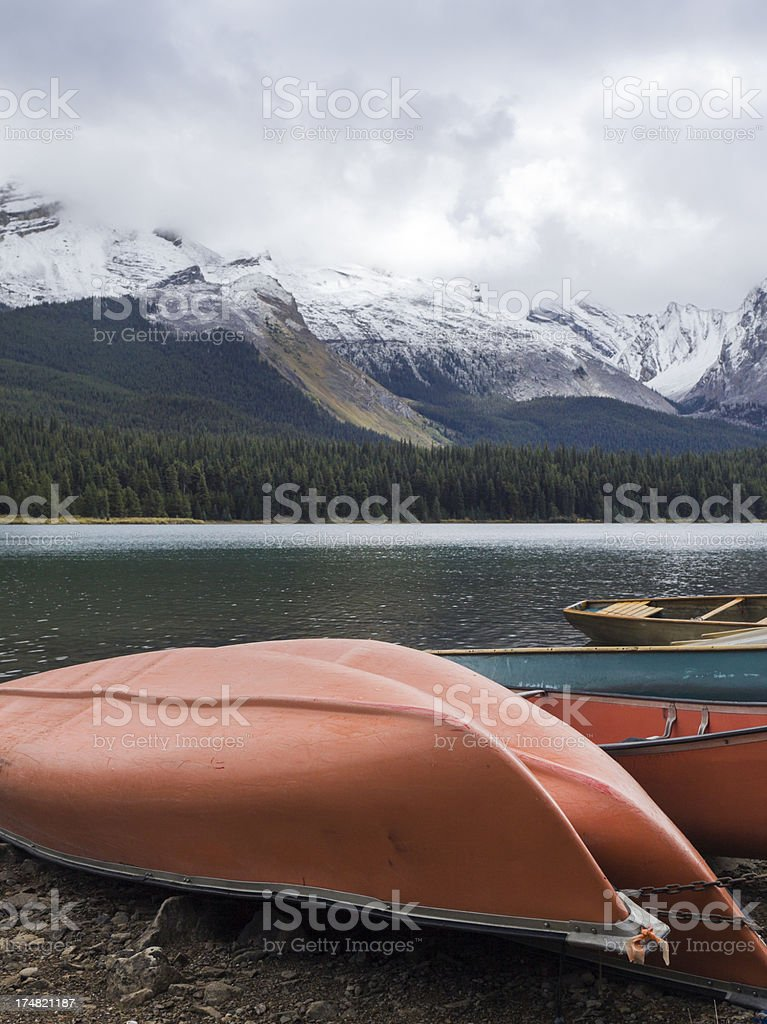 Canoes on a lake shore royalty-free stock photo