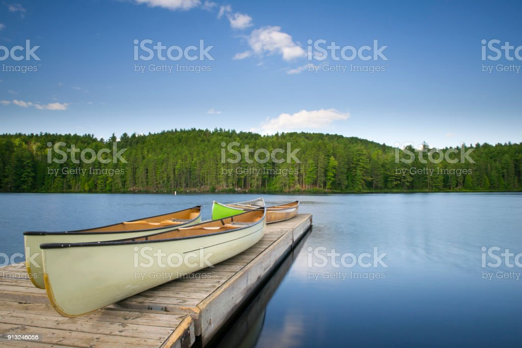 Canoes on a wooden dock stock photo