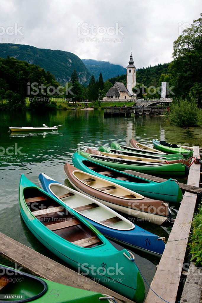 Canoes on the Lake Bohinj stock photo