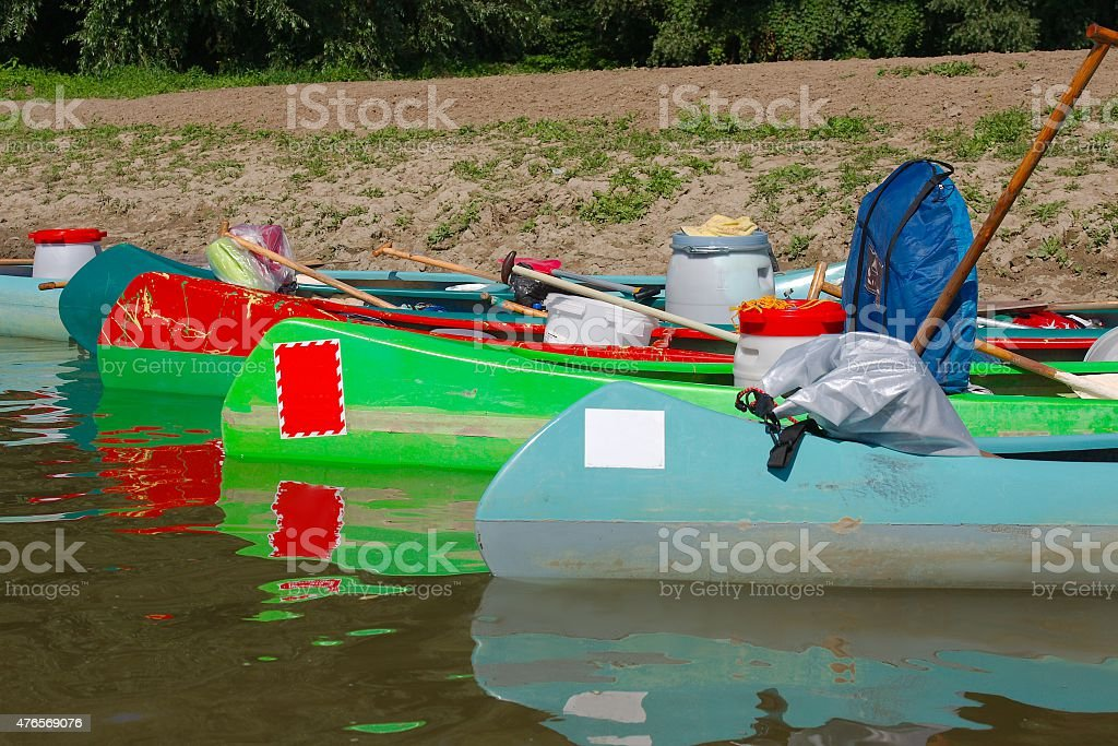 Canoes on the Riverside stock photo