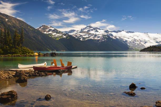 Canoes on west side of Garibaldi Lake Hiking Trail stock photo