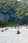 Aiguèze, France, 08/18/2013\nmany canoes and kayaks approaching on Ardeche river