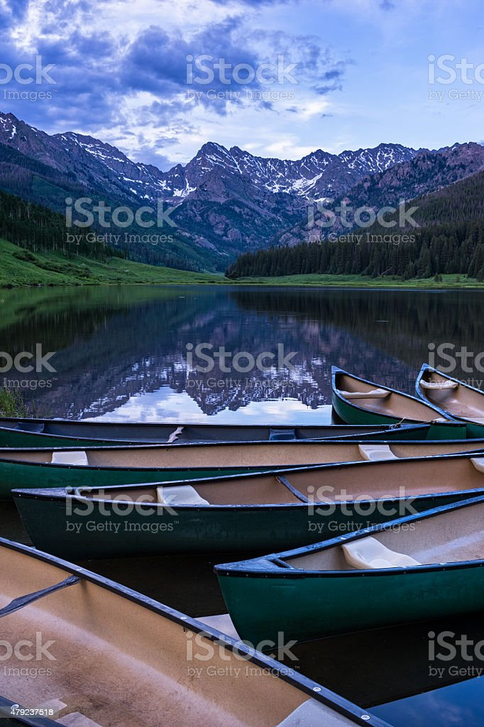 Canoes Reflected in Mountain Lake stock photo