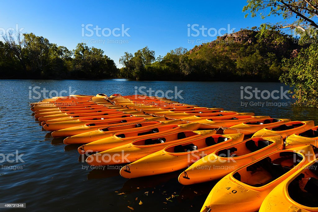 Canoes tied up on water stock photo