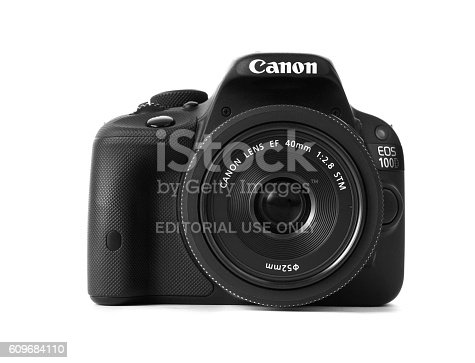 Hamburg, Germany - September 23, 2016: Studio shot with focus of the front of a new canon 100d dslr camera with mounted 40mm pancake lens. The canon 100d is the world's smallest, lightest APS-C DSLR (canon)