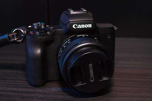 Kragujevac, Serbia - mart 22 2019: Canon eos m50 digital mirrorless camera with kit lens 15-45 f3.5-6.3 on table. Newer model of canon digital mirrorless camera from 2018 with Digic 8 processor and 24 mpix sensor.