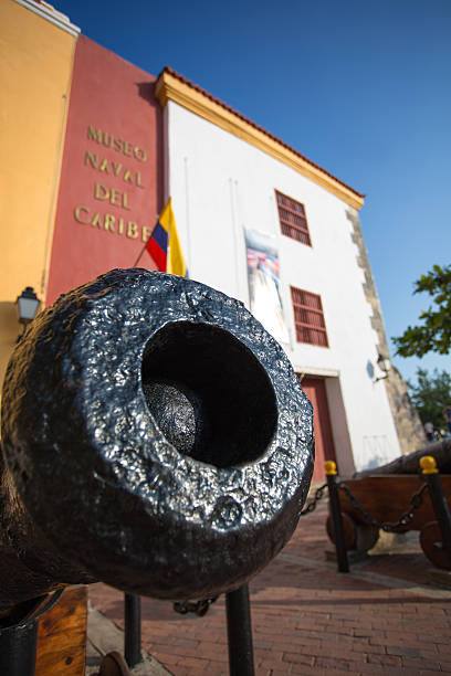 canon in front of the caribbean naval museum - cartagena museum stock photos and pictures