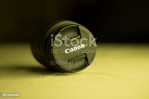 İstanbul, Turkey - October 6, 2014: Canon 18-55 EFS Lens on Table. 18-55 EFS Canon Lens using for all shooting types and also this lens selling with the Canon 600D and Canon 650D. Most of people prefer this less because of the shooting angle and using performance.
