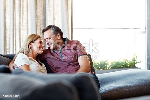 638771390istockphoto Canoodling on the couch 513480052