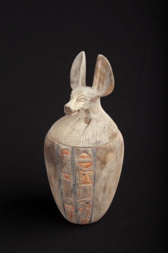 istock Canopic jar with jackal head as lid on black background 157587275