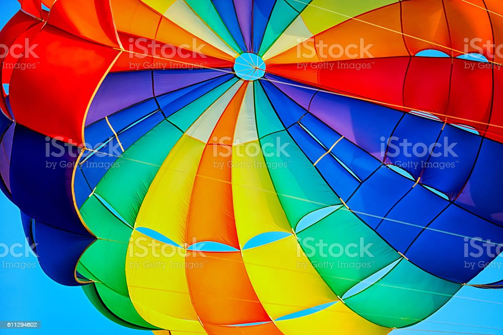 Canopy of a multicolor parachute in air. – Foto