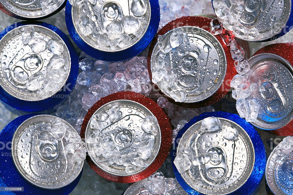 Cans of drink on crushed ice stock photo
