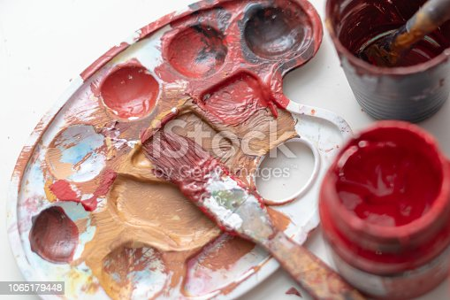 123499844istockphoto Cans of Gouache Paint with Paintbrush 1065179448