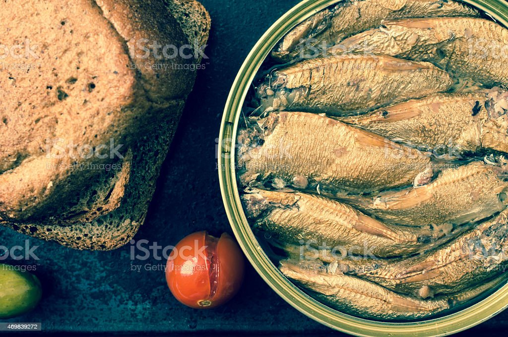 Cans of smoked sardines top view stock photo