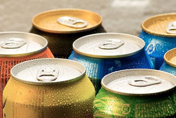 cans of soft drink - soda pop stock photos and pictures