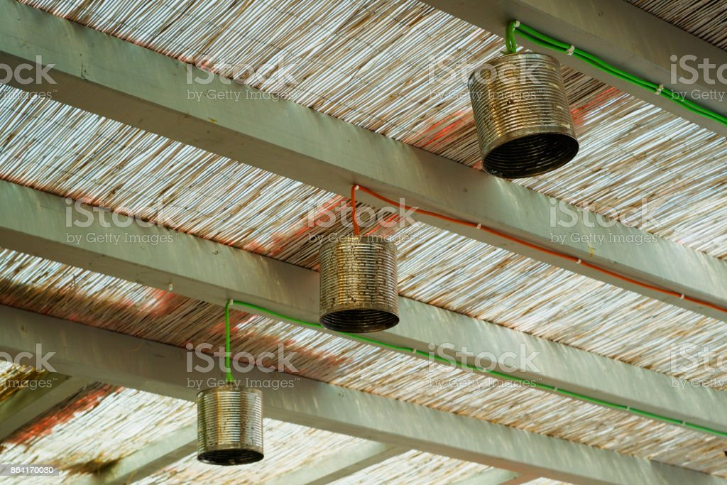cans reused as light shades stock photo