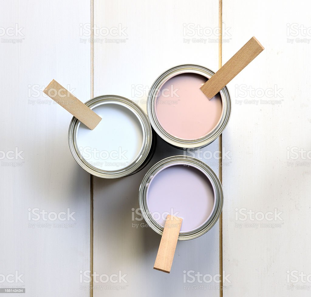 cans with brown, white and lavender paint stock photo