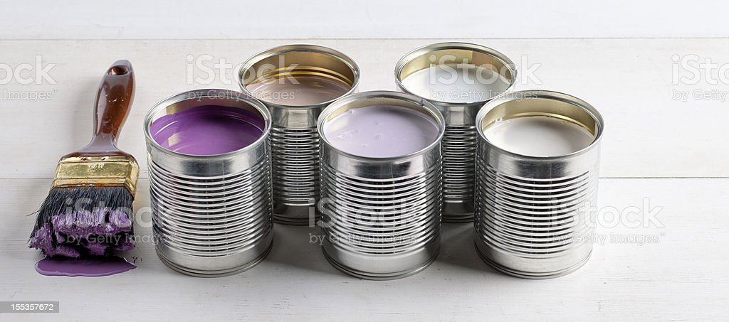 cans with pink, purple, white and lavender paint royalty-free stock photo
