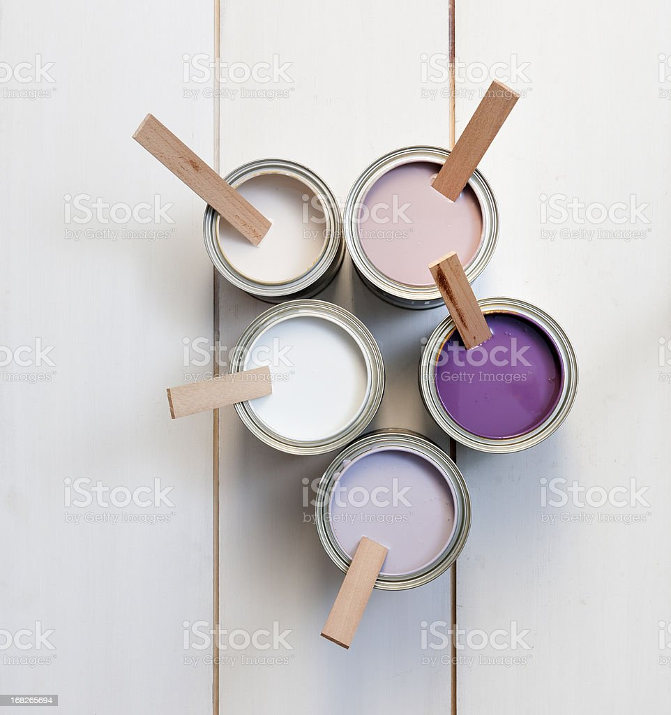 cans with purple, pink, white and lavender paint stock photo