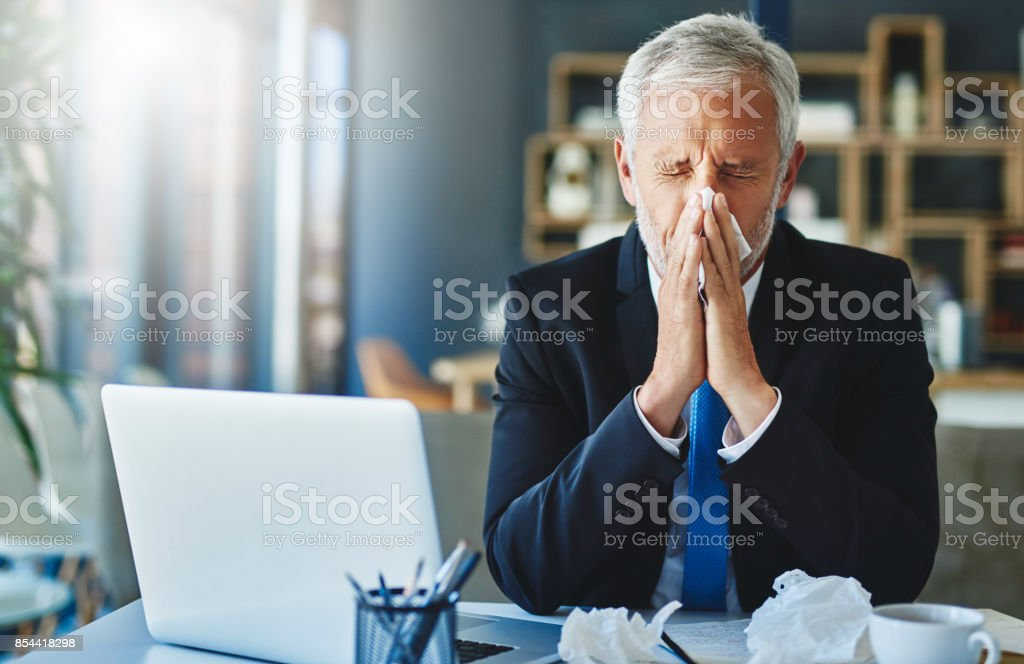 I can't afford to be sick now stock photo