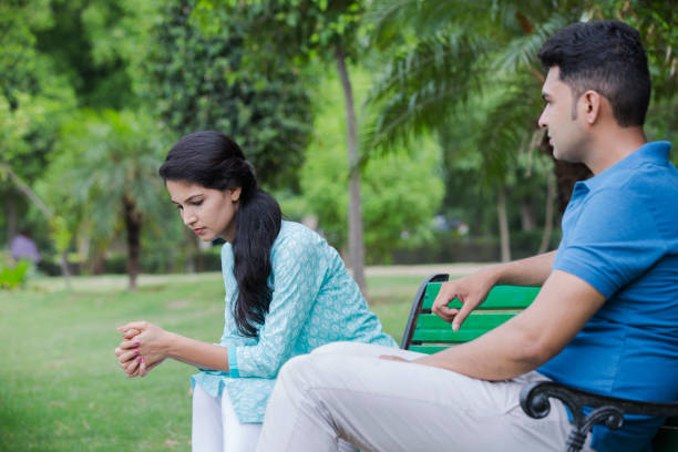 I can't believe he said that - Stock image Dating, Sofa, outdoor, India, Arguing asian couple arguing stock pictures, royalty-free photos & images