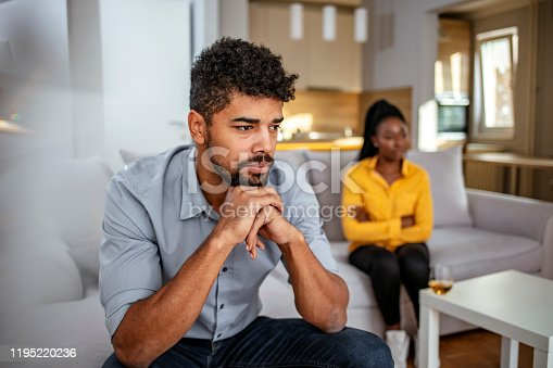 Unhappy Young American Woman Having Argument With Man At Home.