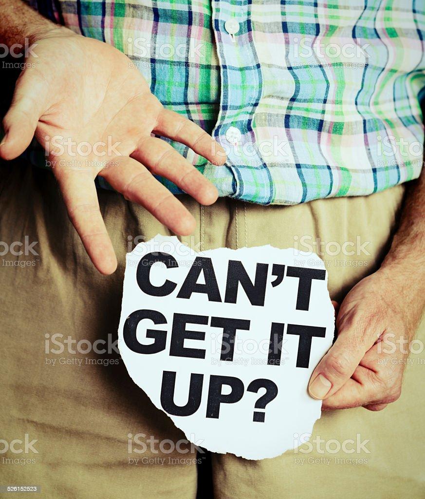 'Can't get it up?' asks headline held over pelvis stock photo