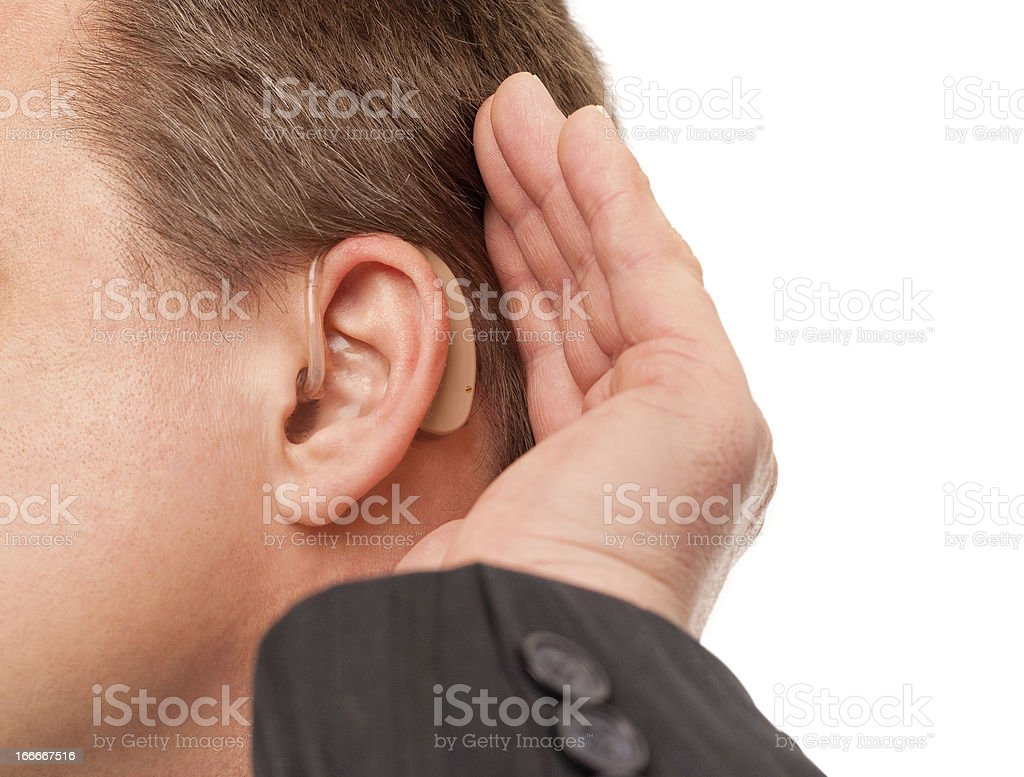 I can't hear you using hearing aid royalty-free stock photo