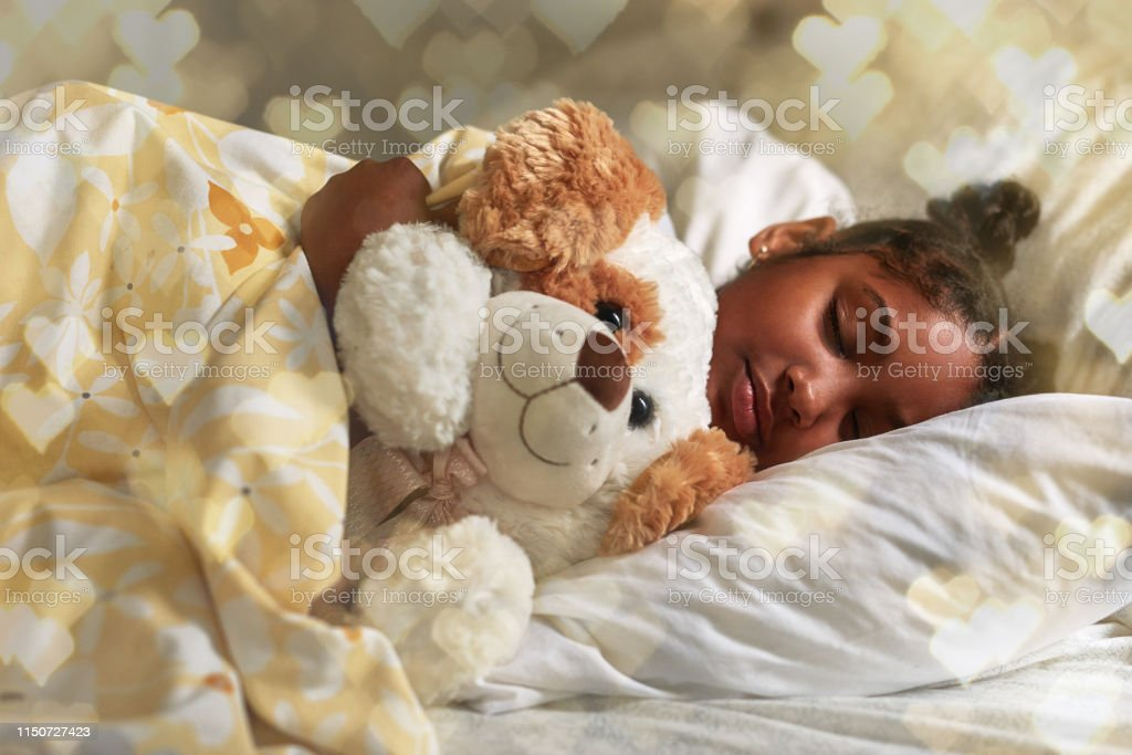 I can't sleep without my teddy Shot of an adorable young girl sleeping peacefully in her bed African Ethnicity Stock Photo