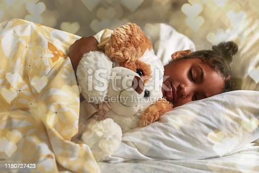 Shot of an adorable young girl sleeping peacefully in her bed