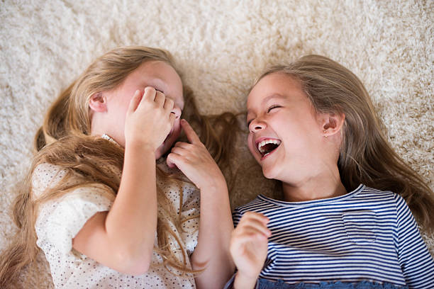 Can't stop laughing when they are together Can't stop laughing when they are together sister stock pictures, royalty-free photos & images