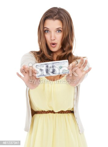 Studio portrait of a cute young woman holding out a dollar bill