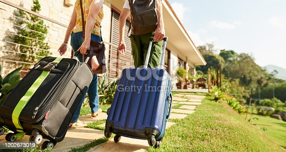 Rear view shot of a traveler couple arriving at their holiday resort