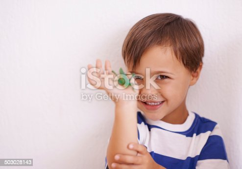 A young boy holding a bug