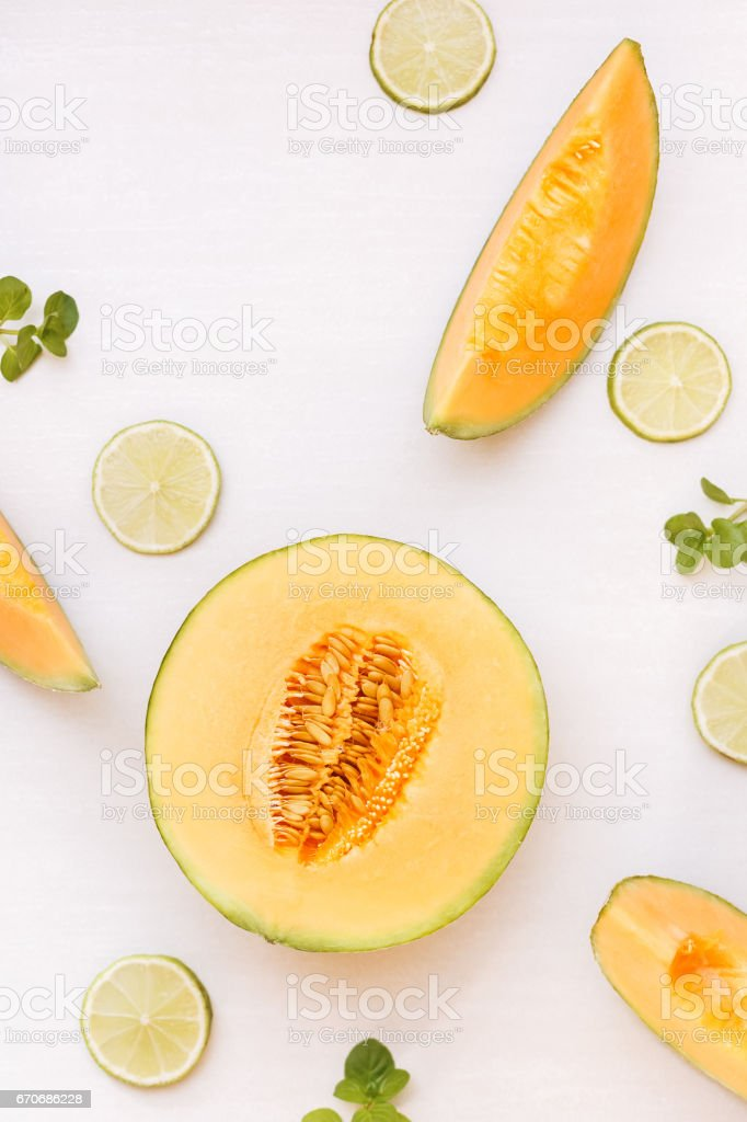 Cantaloupe melon half and slices and lime royalty-free stock photo