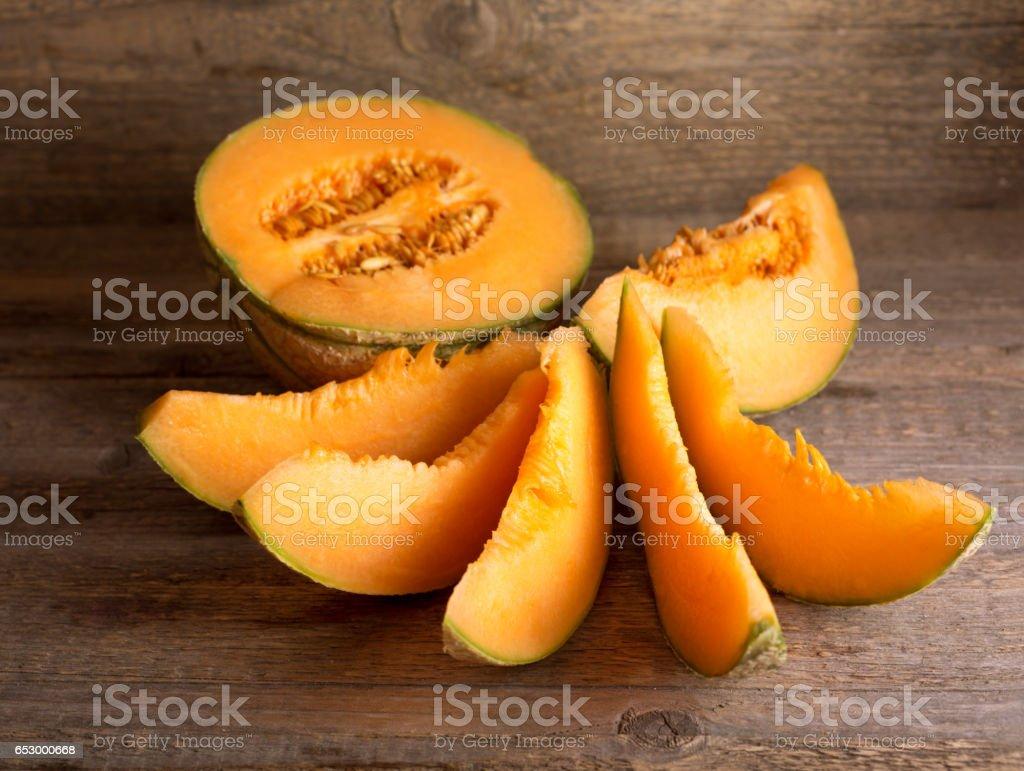 cantaloupe melon on wooden background stock photo