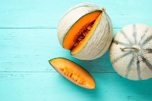 Cantaloupe Melons On Aquamarine Background Stock Photo Download Image Now Istock The cantaloupe, rockmelon (australia and new zealand), sweet melon, or spanspek (south africa) is a melon that is a variety of the muskmelon species (cucumis melo). https www istockphoto com photo cantaloupe melons on aquamarine background gm962219434 262788397