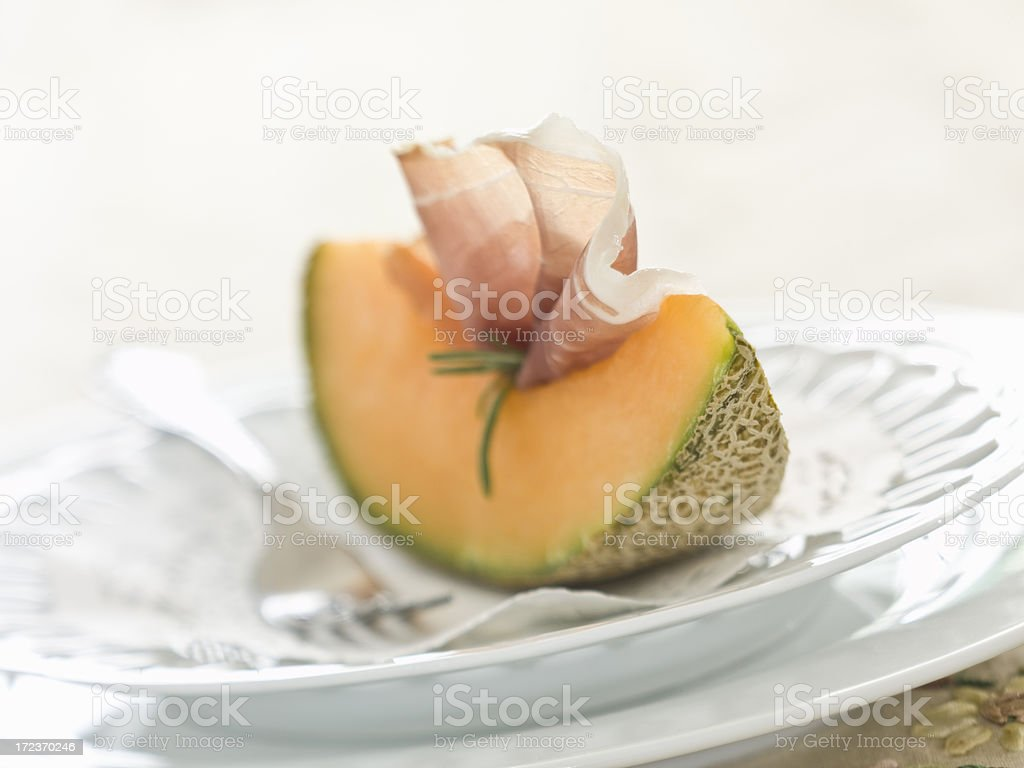 cantaloupe prosciutto--extremely limited focal range stock photo