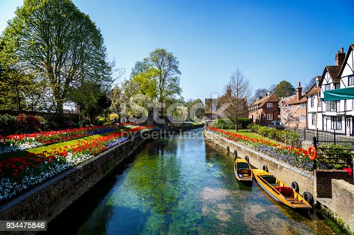 Canterbury, England - A shot looking up one of the many beautiful canals of Canterbury.  This city can be found in the South East of England and is extremely popular with tourists from all over the world.  Tourists can take punting tours on the canal.