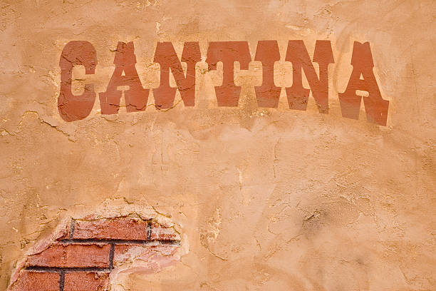 Cantina Sign Outside Bar, Brick Stucco Wall, Rustic, Cinco-de-Mayo Old sign on stucco wall. More signs, backgrounds and southwest images below. saloon stock pictures, royalty-free photos & images