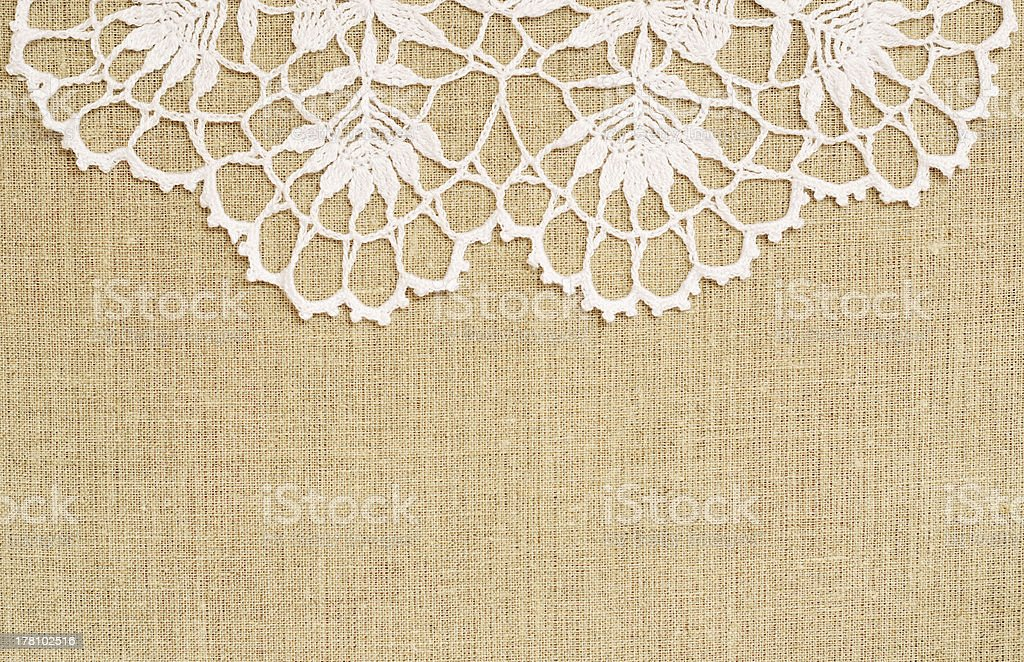 Canvas background with crochet lace royalty-free stock photo