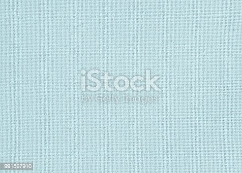 istock Canvas burlap natural fabric pattern background for painting in pastel teal blue color 991567910
