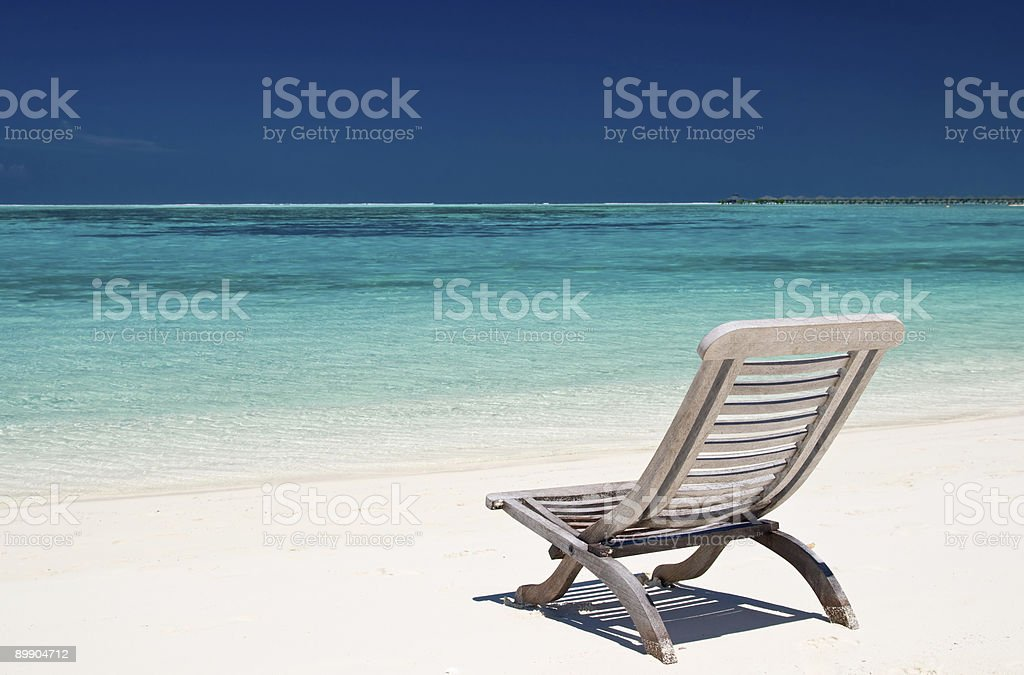 canvas Stuhl am tropischen Strand Lizenzfreies stock-foto